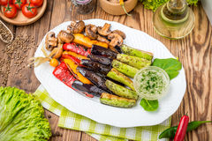 Roasted vegetables on the grill. Zucchini, mushrooms paprika Stock Photos