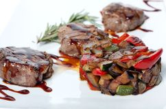 Roasted vegetables and grilled meat. With chocolate sauce Royalty Free Stock Image