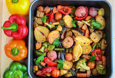 Roasted vegetables. Roasted with herbs sweet potatoes, carrots, peppers,onions,broccolli Royalty Free Stock Image