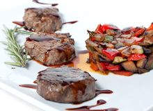 Roasted vegetables and meat. With chocolate sauce Royalty Free Stock Images