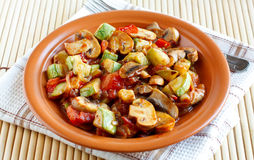 Roasted vegetables on a rustic plate Stock Photo