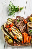 Roasted vegetables and steak with salt Royalty Free Stock Photo