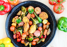 Roasted vegetables. Roasted sweet potatoes, carrots, peppers,onions,broccolli,capsicum,red peppers garnished with herbs and coriander royalty free stock photography