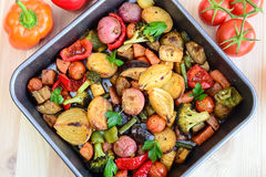 Roasted vegetables. Roasted sweet potatoes, carrots, peppers,onions,broccolli,capsicum,red peppers garnished with herbs and coriander Royalty Free Stock Photos