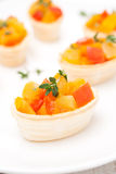 Roasted vegetables with thyme in tartlets on the plate, close-up Royalty Free Stock Photography