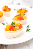 Roasted vegetables with thyme in tartlets on the plate Royalty Free Stock Image