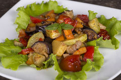 Roasted vegetables on a white plate Stock Photo