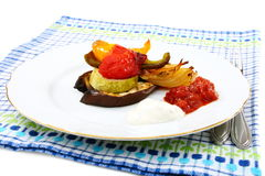 Roasted vegetables with yogurt and tomato sauces. Royalty Free Stock Image