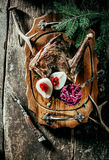 Roasted Venison Haunch with Pears on Wooden Tray. High Angle View of Roasted Venison Haunch on Wooden Tray with Prepared Pears on Rustic Table with Evergreen stock photos