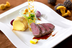 Roasted venison with polenta and chanterelles, medium fried Stock Photography