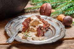 Roasted venison and wild mushrooms Royalty Free Stock Image