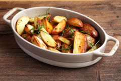 Roasted wedges with herbs Royalty Free Stock Photos