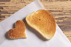 Roasted white bread with a heart-shaped royalty free stock photography