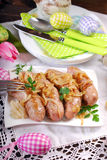 Roasted white sausage with onion for easter Stock Image