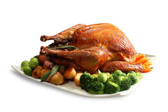 Roasted Whole Chicken. Garnished with vegetables Royalty Free Stock Image