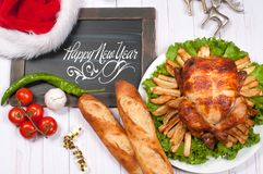 Roasted whole chicken and apple pie with Christmas decoration. Christmas dinner. Thanksgiving table served with turkey.  stock photography