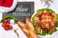 Roasted whole chicken and apple pie with Christmas decoration. Christmas dinner. Thanksgiving table served with turkey.  royalty free stock photos