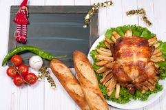 Roasted whole chicken and apple pie with Christmas dinner. Roasted whole chicken and apple pie with Christmas decoration. Christmas dinner. Thanksgiving table Royalty Free Stock Image