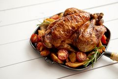 Roasted whole chicken in cast iron black pan stock photo