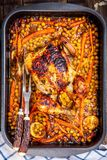 Roasted whole chicken with chickpeas, carrots and lemons Stock Photos