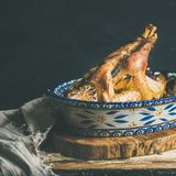 Roasted whole chicken for Christmas, black wall background, copy space Stock Photos