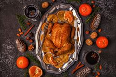 Roasted whole chicken with Christmas decoration. Royalty Free Stock Photos