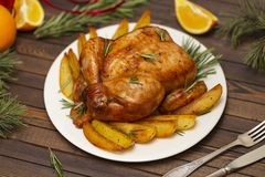 Roasted whole chicken with Christmas decoration. royalty free stock photo