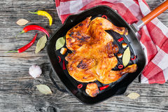 Roasted whole chicken in grill pan with garlic,chili Stock Image
