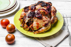 Roasted whole chicken. Lunch dish with roasted carcass of chicken in plum sauce stock images