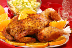Roasted whole chicken with oranges Royalty Free Stock Image