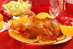 Roasted whole chicken with oranges Stock Photo