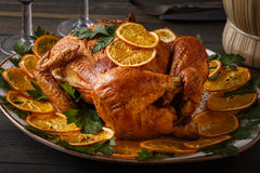 Roasted whole chicken with parsley and oranges. Royalty Free Stock Photo