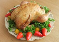Roasted whole chicken on a plate Stock Photo