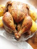 Roasted whole chicken with potatoes Stock Image