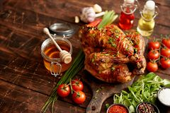 Roasted whole chicken or turkey served with chilli pepers and chive royalty free stock photo