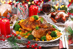 Roasted whole chicken with vegetables on christmas table Royalty Free Stock Image