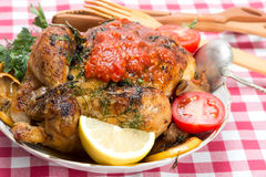 Roasted whole chicken with vegetables Stock Photo