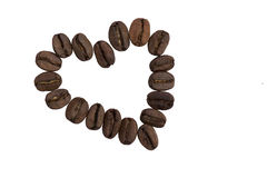 Roasted Whole Coffee Bean in heart shape. On white background Royalty Free Stock Photo