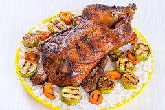 Roasted Whole Duck in honey mustard soy glaze on a yellow platter white background, close-up Stock Photos