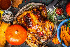 Roasted whole turkey or chicken served with pumpkin, grilled vegetables and corn, top view Royalty Free Stock Images