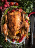 Roasted whole turkey and vegetables Stock Images