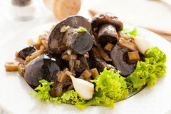 Roasted wild cap boletus with garlic and parsnips Royalty Free Stock Photo