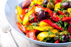 Roasted yellow and red bell pepper salad. Grilled vegetables. Stock Photos
