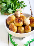 Roasted young potatoes Stock Image