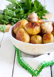 Roasted young potatoes Stock Photos