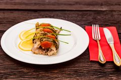 Roasted zander fillet with asparagus and lemon. Close up plate with pike perch fillet, lemon, tomato and asparagus. Healthy diet concept Royalty Free Stock Photo
