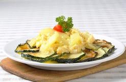 Roasted zucchini with potato egg scramble. Roasted zucchini slices with potato and egg scramble Royalty Free Stock Photo