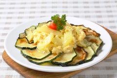 Roasted zucchini with potato egg scramble. Roasted zucchini slices with potato and egg scramble Stock Photography
