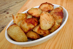 Roasties in a serving dish Royalty Free Stock Photo