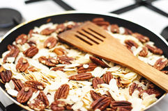 Roasting almonds and pecan nuts Stock Photo